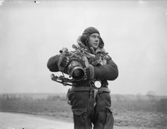 PHOTOGRAPHY DURING SECOND WORLD WAR (C 128)   An RAF airman in full flying kit carrying an F24 aerial camera, France.1940