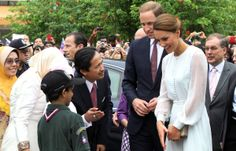 September 14, 2012 - Britain's Prince William and his wife Catherine, the Duchess of Cambridge meets with students while walking in the gardens of the KLCC in Kuala Lumpur, on the second leg of a nine-day Southeast Asian and Pacific tour marking Queen Elizabeth II's Diamond Jubilee. AFP PHOTO (Photo credit should read AFP/AFP/GettyImages)