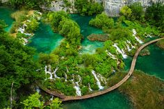 A view of waterfalls in Croatia's Plitvice Lakes National Park. The park is made up of cascading lakes that range in color from green to blu...