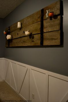 I think this is a barn door, but could it be done with pallets.  Perhaps the little shelves could hold candles.