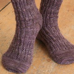 Ravelry: Two-Block Socks pattern by Knitwise Design. Pattern has two different versions of this engaging to knit rib pattern. Sized and suitable for both women and men. #knitwisedesign
