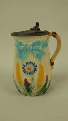 Majolica Fielding daisy ribbon and bow pewter top syrup