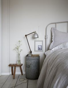 gray bedroom with pop of color love this simple rustic seaside coastal bedroom with whitewashed floorboards industrial lamp and galvanised metal table and pale grey walls Gray Bedroom, Trendy Bedroom, Bedroom Decor, Bedroom Furniture, Bedroom Ideas, Dark Furniture, Furniture Market, Furniture Removal, Wall Decor