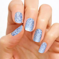 Product # FMG099 Ice Castle Ice Castle, a glitter nail look in shades of pale blue, is the epitome of glitzy winter sparkle!  Glitter finish. Each set includes 16 double-ended nail polish strips.   Price: $12.00