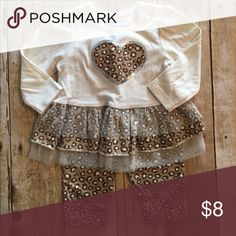 Baby girl 2 piece pant set 6-9 months Leopard and cream colored 2 piece outfit. Leopard heart with silver sequin border design. Only worn oncez buster brown Matching Sets