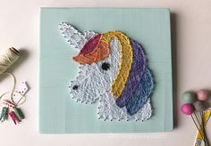 **MADE TO ORDER** Lularoe colored unicorn string art sign Details: ..Wood string art sign measures approx. 12x12 ..wood color: shown in distressed aqua. you can pick a any color, leave in note to seller ..string: shown in LuLaroe colors ..no hanging hardware is included with sign BUT you have the choice to add it in the drop down menu when you purchase for $2 --Current turnaround time is approximately 3-4 weeks, plus an additional days for shipping. There is a rush my order listing ava...