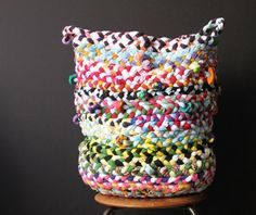 12 DIY catch-all projects an DIY catch-all basket made of upcycled old t-shirts braided and sewn together http://www.apartmenttherapy.com/craft-a-catchall-12-diy-projects-for-cute-functional-small-home-organizers-202314