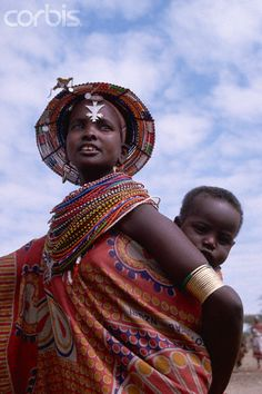 Africa | Masai women with a baby on her back.  Kenya | © Carl & Ann Purcell/Corbis