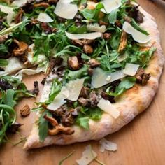 Wild Mushroom Pizza with Arugula & Pecorino - EatingWell.com
