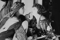"""nitratediva:  Rare candid footage of Rudolph Valentino goofing off with Agnes Ayres on the set of The Sheik. Part of me watches this and goes, """"Shameless hussy!"""" The other part goes, """"Well, yeah, that's how I'd be acting around Rudy, too."""""""