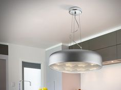LED pendant with anodized aluminium shade, silver finish. Frame made of chromed metal. Lower acrylic diffuser with mesh texture generating optical effects of an arch shape.