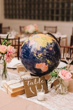 vintage navy blue globe wedding centerpiece / http://www.deerpearlflowers.com/travel-themed-wedding-ideas-youll-want-to-steal/2/