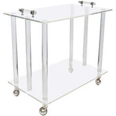 A Midcentury Two-Tier Lucite Service and Bar Cart on Casters
