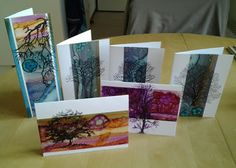 Use alcohol inks on a silver duct tape and place on cards. Overstamp with black ink.