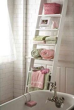 Old Ladder...painted white and re-purposed into useful bathroom storage.