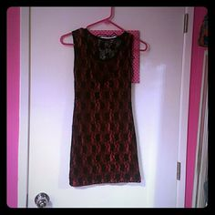 Lace pink and black bodycon dress Black lace overlay with hot pink underneath.  Runs a bit tight. . Never worn. Dresses Mini