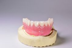 Hybrid dentures are a great solution for people who are missing entire sets of teeth. These implant-supported dentures don't shift against the jaw ridge or cause food to get trapped, and unlike traditional dentures, they feel much more like your natural teeth. However, like all tooth replacement methods, hybrid dentures require diligent care in order to keep them in good shape. Here's how you can keep your new hybrid dentures in fantastic condition in three easy steps. Tooth Replacement, Oral Surgery, Dental Implants, Dental Care, Teeth, Shapes, Traditional, Natural, Ethnic Recipes