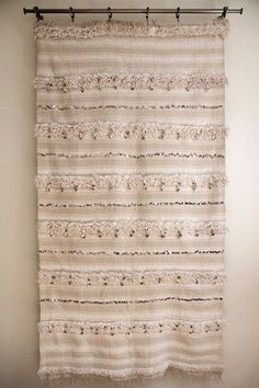 I've seen the textiles used as wall hangings and on ottomans, but I'd like one to wrap myself in - just like Berber brides used to do.