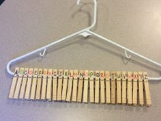 Clothespins on Hangers to practice alphabetical order. Lots could be done with this idea