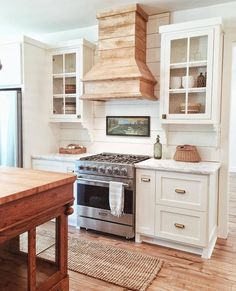 white kitchen with natural wood tones-so gorgeous!