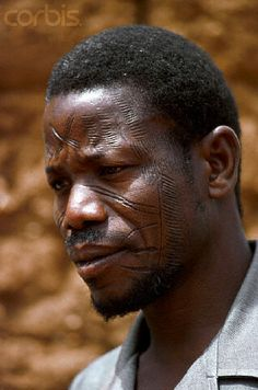 Africa | A Bobo chief displays tribal scars on his face in Burkina Faso. | © Charles & Josette Lenars