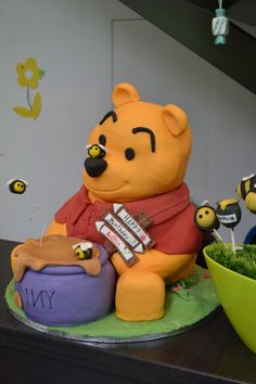 Winnie the pooh cake and candy table