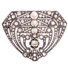 Art Deco Pearl Diamond Platinum Brooch | From a unique collection of vintage brooches at https://www.1stdibs.com/jewelry/brooches/brooches/