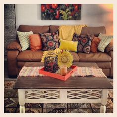 Warm but rustic. Love the coffee table and couch. Great addition of colors