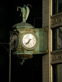 This art nouveau clock is attached to the north-east corner of the Jewelers Building at 35 East Wacker Drive, Chicago, Illinois.  On top of the clock stands an angel holding a scythe and an hourglass to remind us of the inexorable passage of time.