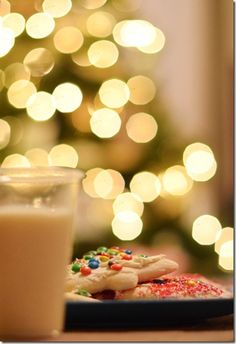 cookies in milk in front of a Christmas tree