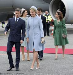 Crown Prince Frederik was animated as he walked with Queen Mathilde at the event ...