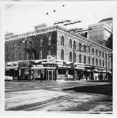 """The Alberta Hotel, circa 1962. The Alberta Hotel was built in 1888-89 at a cost of $36,000 and boasted the """"Long Bar"""", 125 feet of polished wood and glass, reputed to be the longest bar in Western Canada at the time. The eve before the bar closed in 1916 due to prohibition veteran barman Tom Pierce """"dispensed enough liquor to fill every horse trough in Alberta."""""""