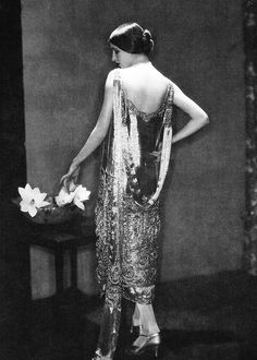 Model Marion Morehouse wearing an evening gown by Chanel, 1924. Photographed by Edward Steichen.