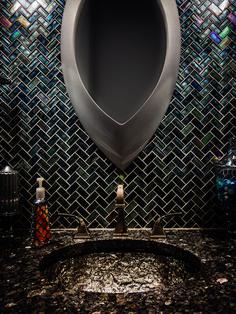 "Go bold in small spaces like this powder room featuring ""Blue Pearl"" Granite & a ""Cobalt Sea"" Herringbone Mosaic."