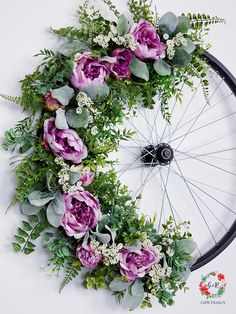 Who doesnt love vintage bicycles? This beautiful Vintage bicycle wreath is made with a real bicycle wheel and to best quality silk florals out there. This unique bicycle wheel wreath will make a wonderful focal point for any area in your house you want to show off your good taste! The