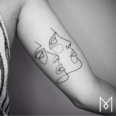 Continuous line faces on the left inner arm. Tattoo artist: Mo Ganji