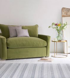 Loaf's comfy new Pavilion love seat sofa bed in Olive green velvet in this art deco living room with flashes of brass