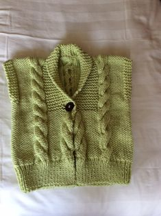 A beautiful ladies hand knitted waistcoat in light green. Size 36/38. Knitted in a super chunky yarn.