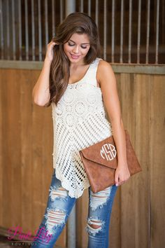 This classic ivory tank is such a beautiful way to welcome fall! Featuring intricate ivory crocheting and soft fabric, it gives a gorgeous boho look with lots of comfort!