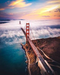 San Francisco's iconic Golden Gate Bridge stretches into a sea of fog, as seen from a helicopter. California's Golden Gate National Recreation Area, which borders the bridge, is just as stunning at ground level. To the west, Kirby Cove features. Places To Travel, Travel Destinations, Places To Visit, Lonly Planet, Puente Golden Gate, Voyage Usa, Ville New York, Local Photographers, San Francisco California