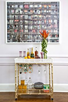 The Madison Mixer Bar Cart. Lovely retro look.  http://www.shopsocietysocial.com/products/the-madison-mixer
