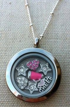 Origami Owl - cheerleading  Hello, I am Danielle Dombkowski, an Independent Designer for Origami Owl.  I love what I do!!!!If you are interested in buying a Living Locket, or joining my team, (which is SO much FUN, and a great way to make great money!!!!)  I would LOVE to hear from you. Book a party, and earn amazing jewelry for FREE. I am in the New England area and willing to travel. www.tangledinlockets.origamiowl.com Designer ID # 40207 Ootangledinlockets@gmail.com