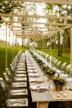 Our favorite DIY project was building a 60' long farmhouse table with a modern trellis to hang lighting. Clear ghost chairs mixed in a touch of modern for the ceremony and dinner.