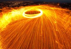 Playing With Fire: Steel Wool Spinning in the Landscape. A Post By: Andrew Gibson. Photo Caption: Focal length 21mm, shutter speed 15 seconds. http://digital-photography-school.com/playing-fire-steel-wool-spinning-landscape