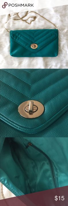 Teal clutch with chain This is a lovely bag. Outside is in excellent condition. Inside has normal gently used condition wear. I can't decide if the hardware is silver or gold, so I guess it could go both ways. From a boutique. Bags Clutches & Wristlets