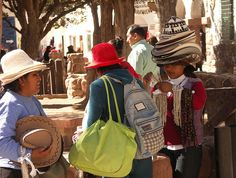 """Hmahuaca in Jujuy Province, Argentina; the woman with the hats reminds me of the kids book """"Caps for Sale"""""""