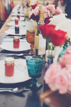i love everything about this table setting from the mismatching dishes to the colored glasses and the homemade jam. via bleubird vintage