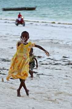 Don't steal my soul!  A funny joke with a girl on the beach in zanzibar makes it seem like her pose a dance step