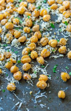 These crispy roasted parmesan chickpeas are a healthy snack loaded with protein, fiber, and a whole lot of deliciousness! Gluten-Free + Vegetarian