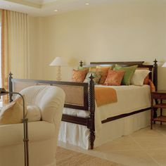 love the combination of orange and green -perfect with the light creamy orange walls- showcases the wood bed frame